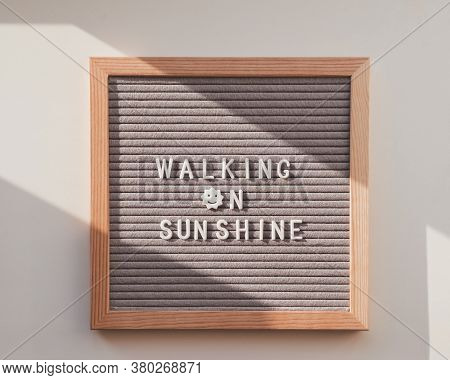 Top View On Letter Board With Word Walking On Sunshine. Flat Lay Concept Symbol Of Warmth And Light.