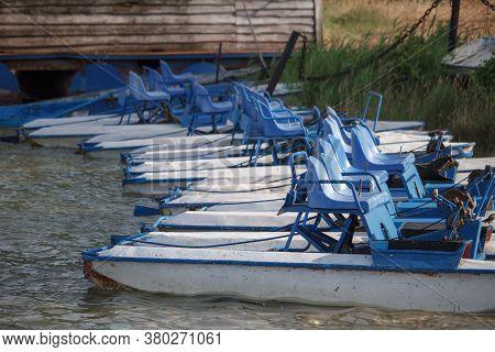 Lot Of White Blue Retro Catamarans On Sandy Beach Of Lake Or River, Catamaran Rental Concept