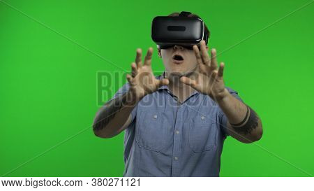Amazed Man Using Vr App Headset Helmet To Play Simulation Game, Drawing. Watching Virtual Reality 3d