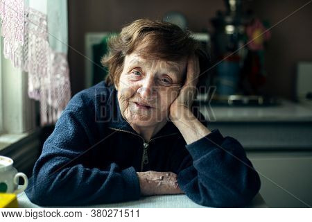Portrait of an Old Woman in the country house.