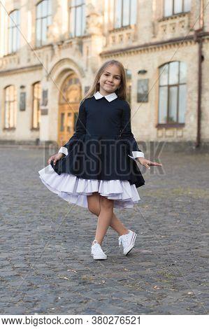 Its Pleasure Of Elegance. Happy Kid Make Curtsy In Uniform Outdoors. Uniform Dress Code. Clothing St