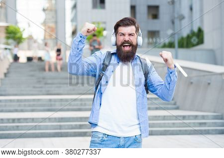 Rewind The Happiness. Happy Hipster Listen To Music Outdoors. Bearded Man Feel Happiness. Happiness