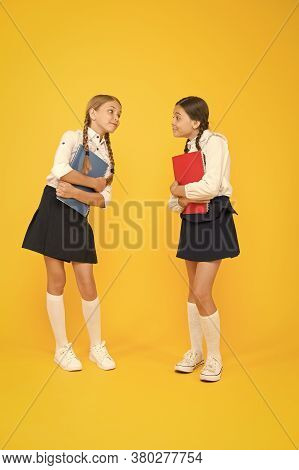 Bright Life. Cheerful Classmates With Workbook. Little Girls In School Uniform. Dictionary Notebook.