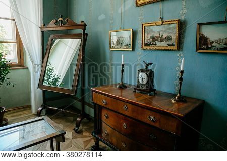 Castle Interior. Bedroom, Chest Of Drawers And Mirror. Castle Kacina, Empire Chateau Near Kutna Hora