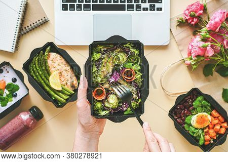 Female Hands Hold Food Delivery Box Having Lunch At Work From Home Office. Business Woman Worker Eat