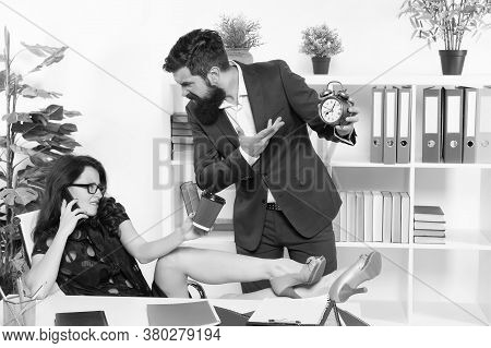 Keep Track Of Time. Bearded Man Point At Clock While Sexy Woman Talking On Phone. Boss And Talky Sec