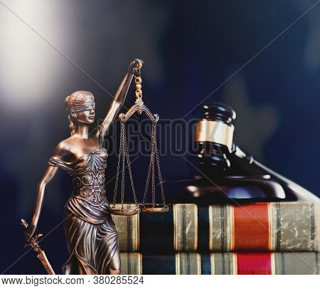 Legal law concept image, gavel with US flag background.