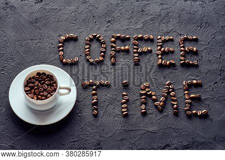 Roasted Whole Coffee Beans In White Porcelain Cup On Saucer And Coffee Time Inscription Made From Co