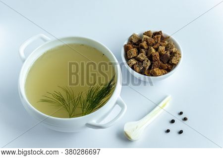 Homemade Meat Broth In A Tureen With Dill. Croutons And . On A White Background. Healthy Food Concep