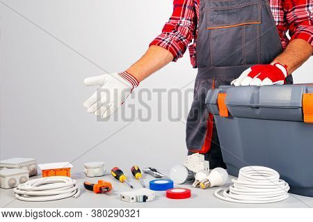 Electrician Showing Equipment For Repair. Labor Day Concept.