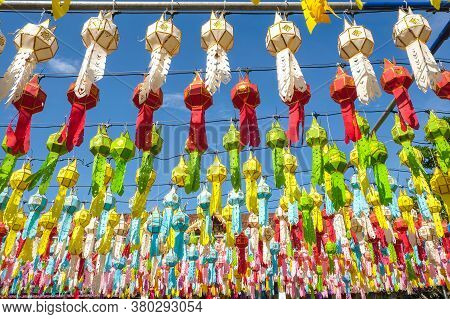Rows Of Traditional Paper Lantern Hanging On Above During Yi Peng (or Yee Peng) Festival In Wat Phra