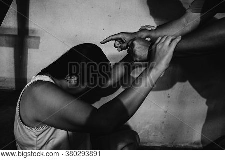 Man Beating Up His Wife Illustrating Domestic Violence. Violence In Relationship.