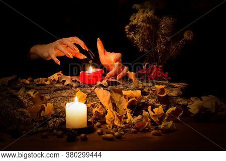 Forest Witch Guessing On Wax On The Altar In The Dark. Female Hands With Sharp Long Nails Making Pas