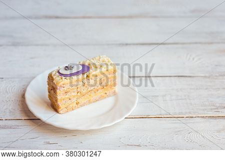 Lavender Cake On A White Plate On A White Wooden Background. Delicate Sponge Cake With Custard. Swee