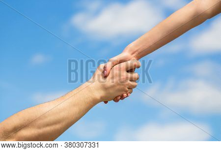 Hands Of Man And Woman Reaching To Each Other, Support. Giving A Helping Hand. Lending A Helping Han