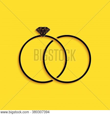 Black Wedding Rings Icon Isolated On Yellow Background. Bride And Groom Jewelery Sign. Marriage Icon