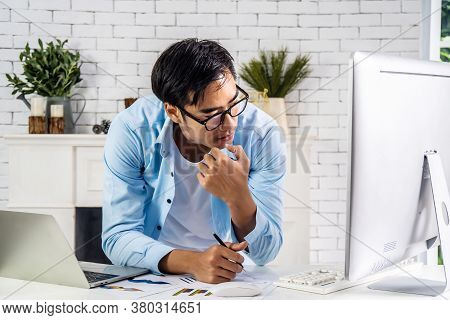 Young Businessman Asian Man Looking At Laptop Pondering Over Problem Solution, Worried Man Gaze At C