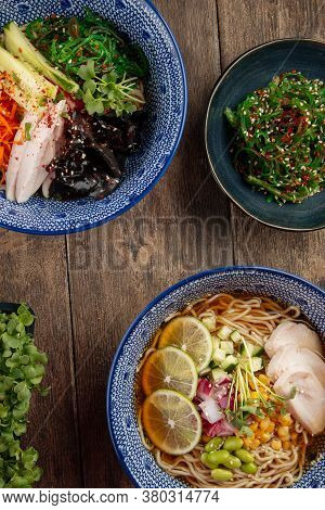 Top View On Asian Japanese Dishes Cold Summer Ramen Soups On The Wooden Table
