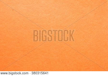 Texture Background Of Orange Velvet Or Flannel