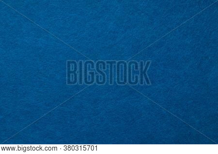 Texture Background Of Dark Blue Velvet Or Flannel Fabric
