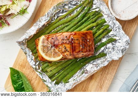 Foil Pack Dinner With Red Fish. Fillet Of Salmon With Asparagus. Oven-baked Hot Dinner