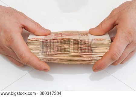 Men's Hands Hold A Large Number Of Banknotes In A Pack Of Five Thousand Rubles