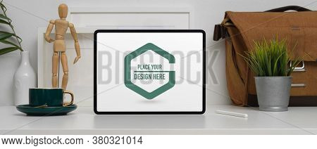 Home Office Desk With Mock Up Digital Tablet, Coffee Cup, Bag And Decorations