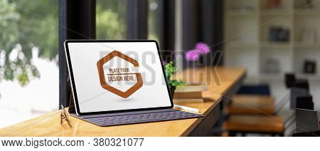 Mock Up Digital Tablet With Keyboard On Wooden Counter Bar