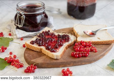 Sandwich Or Toast With Red Currant Jam Or Marmalade. Delicious Breakfast With Homemade Jam.