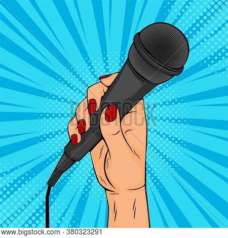 Girl Or Woman Hand Hold Microphone Cartoon Vector Illustration In Pop Art Retro Comic Style. Enterta
