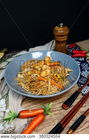 Pad Thai, vegan recipe made with rice noodles, vegetables and peanuts cooked on wok