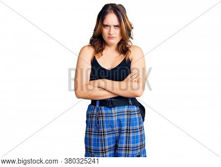 Young beautiful caucasian woman wearing casual clothes skeptic and nervous, disapproving expression on face with crossed arms. negative person.