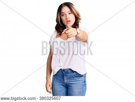 Young beautiful caucasian woman wearing casual white tshirt pointing displeased and frustrated to the camera, angry and furious with you