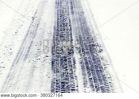 Imprint Of A Car Tire On Wet Snow
