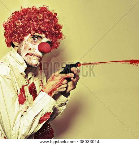 Creepy Manic Clown Shooting Blood From Cap Gun