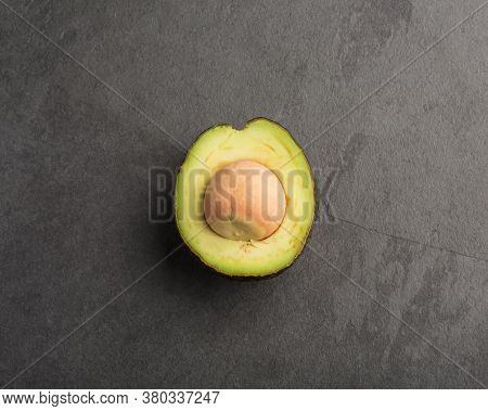 Avocado On Gray Background - Persea Americana 'hass'
