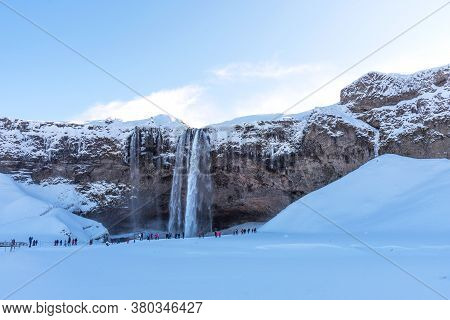 Picturesque Winter Landscape View Of Frozen Beautiful Waterfall Seljalandsfoss In Iceland. Aereal Wi