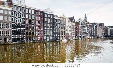 Dutch scenery with canalside houses.