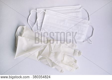 Medical Protective Disposable White Masks And Glove On White Background. Protection Equipment Agains