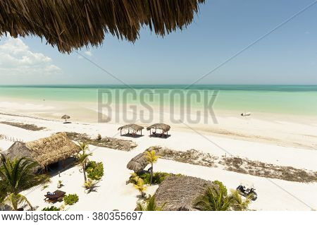 Panoramic Aerial View Of The Caribbean Sea In Holbox Island Mexico. Tourists In Hammocks Relax In Th