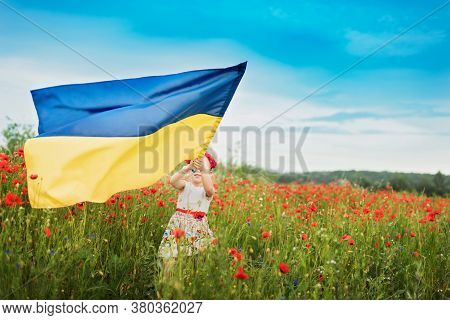 Ukraine's Independence Flag Day. Constitution Day. 24 August. Patriotic Holiday. Girl In Traditional