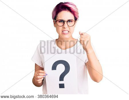 Young beautiful woman with pink hair holding question mark annoyed and frustrated shouting with anger, yelling crazy with anger and hand raised