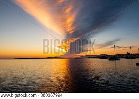 Magnificent Sunrise With Saturated Orange And Purple Bank Of Clouds In The Sky Seen From The Boat On