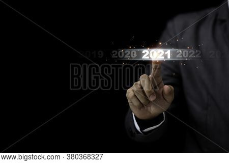 Businessman Touching 2021 Year For Starting New Year And New Business Startup Concept.
