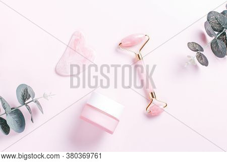 Facial Roller, Gua Sha And Moisturizing Cream With Green Leaves. Natural Cosmetics And Facial Tools