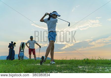 Couple In Action Of Playing Golf Together. Obstacles To Golf Drills In Rough Areas And Difficult Dri
