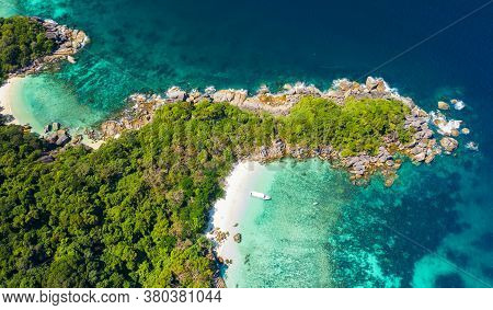 Aerial View Drone Shot Ocean Waves, Beautiful Tropical Beach And Rocky Coastline And Beautiful Fores