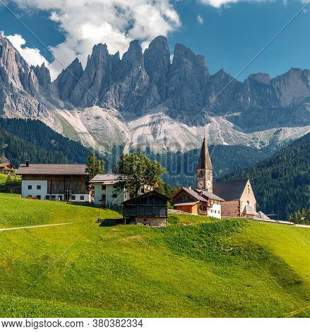 Wonderful Sunny Landscape Of Dolomite Alps. St Johann Church, Santa Maddalena, Val Di Funes, Dolomit