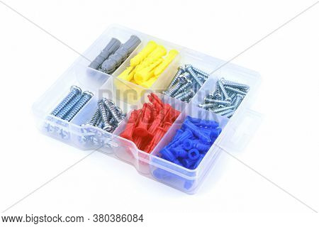 Set Of Colorful Dowel, Screw And Fastener Isolated On A White Background. A Box With Dowel, Bolt And