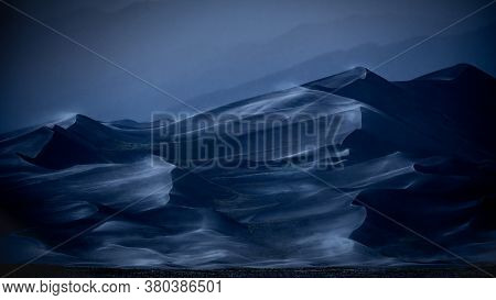 Wind-blown Sand Dunes With An Eerie, Abstract Look